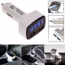 Wholesale-Top Quality 4 In 1 Dual USB Car Charger Adapter Voltage DC 5V 3.1A Tester For iPhone Car Lighter Slot Fast Charging MAY4