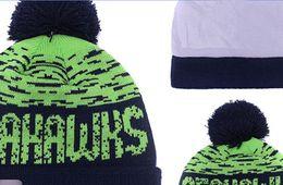 Wholesale 2016 New winter Hot Seahawks Football Pom Beanies Cheap Football Beanies Brand Knit Beanie Hats Popular Warm Winter Caps Sports Team Hats