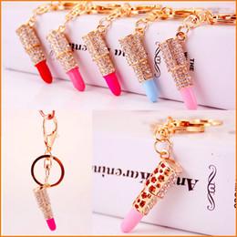 Descuento monederos de las señoras regalos (5 Colores) Lápiz labial Maquillaje Llavero Rhinestone Bolsa bolso Colgante Encanto Llavero Regalo de Navidad para Mujer Señora Mujer
