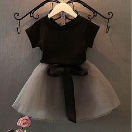 Compra Online Faldas para las muchachas de los niños-Ropa infantil 2016 primavera y otoño bebé niñas algodón mezcla trajes manga corta camiseta y faldas para 2-7 años de edad bebé.