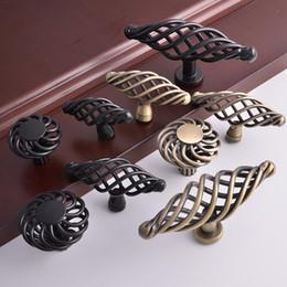 Wholesale antique bronze classical black birdcage nest shaped ellipse round knob american furniture closet cupboard dresser drawer cabinet iron handle