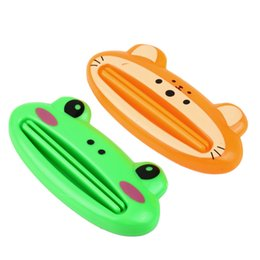 Wholesale random color Brand New Cartoon Easy Squeezer Toothpaste Tube Dispenser Rolling Holder
