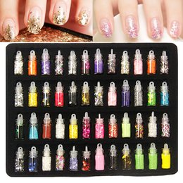 Wholesale 48 bottles nail art charms kit contain random nail art pearl sequin glitter powder acrylic rhinestone and so on
