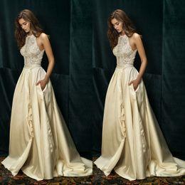 Wholesale Lihi Hod Bridal Dolce Vita Champagne White Ivory Sleeveless Lace Wedding Dresses Halter Neck Lace Bodice Bridal Gowns with Pockets