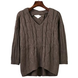 2017 autumn and winter Europe and America V collar solid color back hollow loose knit sweater women's wear