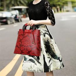 Wholesale Women s fashion new retro national wind handbag Shoulder Messenger portable big bag of logs