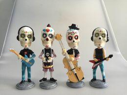 Wholesale resin skull head music band figurine doll