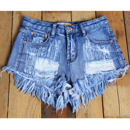 The new Europe and the big hole rivet old jeans shorts sexy shorts female flash