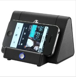 Wholesale audio automatic induction stereo mini wireless phone holder subwoofer portable speaker high fidelity stereo subwoofers music player