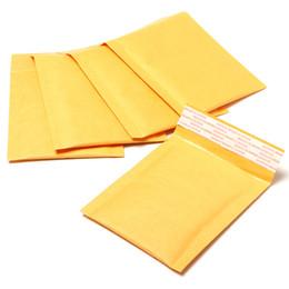 Kraft enveloppe jaune en Ligne-Vente en gros-50 pcs Qulity Kraft sac de bulle enveloppes rembourrées 110 * 130 + 40mm Mailers sacs de publipostage Livraison Sacs jaunes