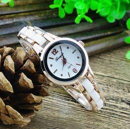 Free shipping!Copy ceramic alloy band,gold plating alloy round case,quartz movement,gerryda fashion woman laldy ceramic bracelet watches