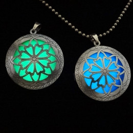 Hot European and American vintage jewelry hollow phase box emitting luminous pendant necklace women can play an open photo
