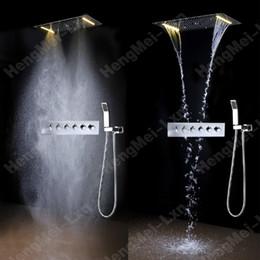Descuento alto acero inoxidable pulido Ducha de Baño 600 * 800mm 304 ducha de ducha de pulido de acero inoxidable eléctrica ducha eléctrica con mezclador multi-función de alto flujo termostático