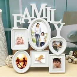 Wholesale Envío gratis Marcos de la familia Marco de la foto Soporte de la pared Soporte de la imagen Exhibición Decoración del hogar Plástico blanco Su mejor opción
