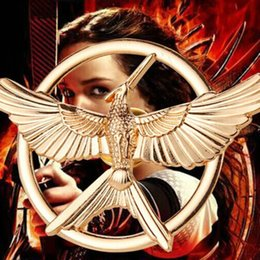 Wholesale 15pcs golden The Hunger Games Flying Eagle Dapeng Roc Mirs wings Volant Hawk spreads its wings mockingbird Brooches pins Corsage boy xz005