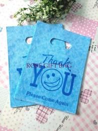 500pcs / lot 15 * 20cm plastique utile sourire bleu visage imprimé Boutique cadeau emballage pratique sac à main sacs à provisions à partir de impression sac de transport fabricateur