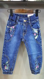 Wholesale Girls tight pants zipper opening characteristic fold embossed waistband elastic leg opening yards of blue jeans
