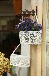 Wholesale wall flower baskets hand woven wall hanging wicker basket hanging basket wicker storage basket fashionable