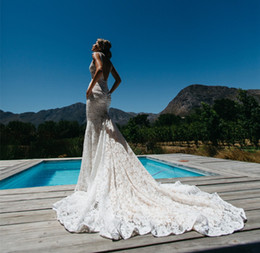 Wholesale Sexy Lace Backless Mermaid Wedding Dresses with Pockets Cheap Illusion Deep V Neck Long Chapel Trains Beach Bridal Gowns