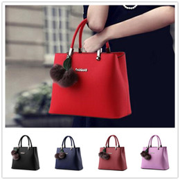 Wholesale Hot sale new fashion hanging hairball zipper embossed women handbag shoulder Messenger cross section BAG99