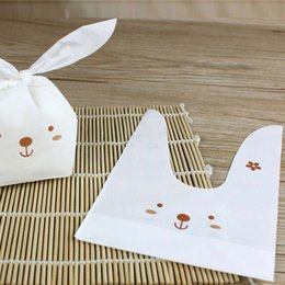 Cute 50pcs lot Rabbit Ear Cookie Bags Food-grade Plastic Candy Biscuit Packaging Bag Wedding Candy Gift Bags Party Supplies