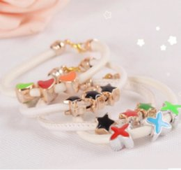 4191 Korean version of the new stars of love Four Leaf Clover Bracelet white candy colors priced at cheap wholesale S077