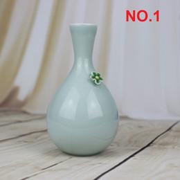 Ваза оптовиков Онлайн-Цзиндэчжэнь фарфоровый керамическая ваза довольно пинч цветочным узором творческие подарки дом / офис украшения Таблица декора Оптовая торговля 5 видов