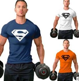 Wholesale 2016 men s gold and silver high cotton products Superman T shirt in the gym bodybuilding hight quality