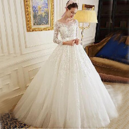 Princess Ball Gown Wedding Dress Illusion Bodice Sheer Neckline Lace Appliqued Tulle Bridal Gowns with Sleeves Sash and Bow Custom Made