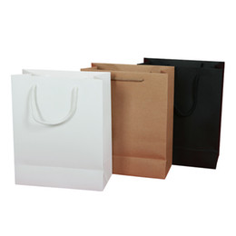 Wholesale vertical stock and customized kraft paper ivory board black paper gift bag paper bag with rope handles