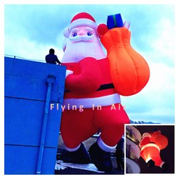 Wholesale 5m m Decorative Christmas Inflatable Santa Claus with Bag for Christmas