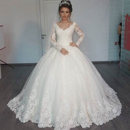 Gorgeous Sheer Ball Gown Wedding Dresses 2019 Puffy Lace Beaded Applique White Long Sleeve Arab Wedding Gowns robe de mariage