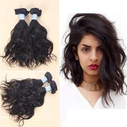 2017 vague d'eau armure bouclée Cheveux naturels ondulés, cheveux ondulés et ondulés cheveux brésiliens tissus tissus trames d'onde d'eau 100% extensions de cheveux humains lâches bouclés budget vague d'eau armure bouclée