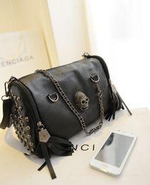 2015 Korean winter skull handbag fashion bag winter style rivet tassel portable bag