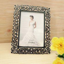 Nouveau cadres de photo de l'alliage de zinc de cadre populaire de mode de mode de vente pour le cadeau de cadre de photo de décoration de bureau pour les amis PF-016 à partir de décor de zinc fournisseurs