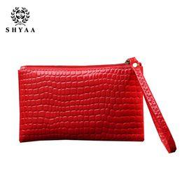 SHYAA nuevo bolso de las mujeres bolsa de cuero embrague hembra cambio pequeño billetera hembra monedero señora cocodrilo moda teléfono móvil bolsa desde monederos de las señoras de color beige fabricantes
