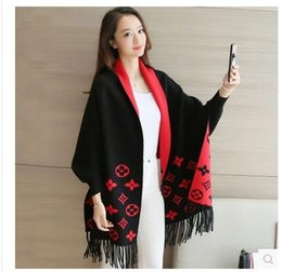 Promotion noir cardigan tricoté 2016 hiver nouvelles femmes drapent long châle Cardigan en maille gros pull noir Tassel cape manteau cape poncho femmes