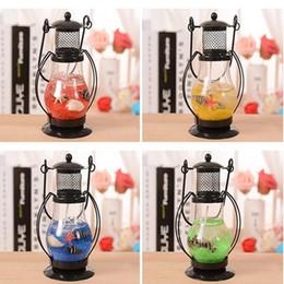 Lampes et lampions romantiques à dîner aux chandelles Lampe d'Aladdin Porte-bougie en verre suspendu Bougie CandleStick Couleur aléatoire à partir de supports métalliques pour le verre fournisseurs