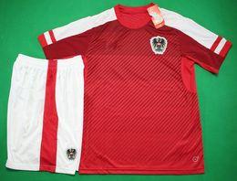 Wholesale Austria home red football uniforms short sleeve designer soccer jersey men s athletic thailand quality sports kit soccer sets