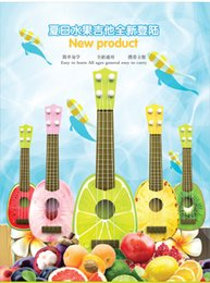 Wholesale New musical instrument product Ukulele small guitar easy to learn and carry children toy or gift