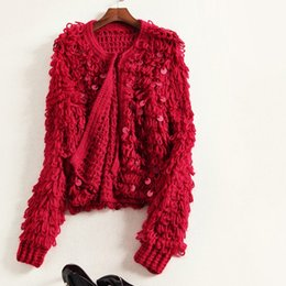 Wholesale Europe and the United States women s new autumn Hand woven in bead piece sweater long sleeved cardigan small coat