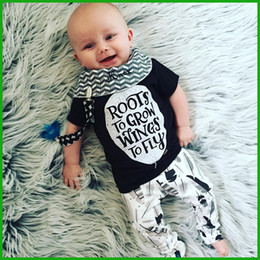 Wholesale 2016 Newborn baby boys girls rompers bodysuits black short t shirt letter decoration infant one pieces sets via epacket