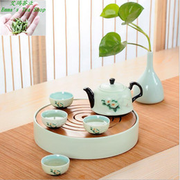 Wholesale Hot Sale with High quality set Green ceramic tea sets portable travel round home tea pot with bamboo tea tray