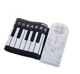 Portable 49 touches électronique flexible claviers pliables musique de piano à la main laminé électronique gros-NEW pour le cadeau pour enfants Learning à partir de 49 main clé roulé de piano fabricateur