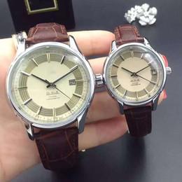Wholesale 2016 Couple Women Men Watch Luxury watches Calendar Round Calibration Dial Genuine Leather Strap Quartz Wristwatch for Men