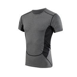 Wholesale Hot Men s Compression Base Layer Gear Tights Bodybuilding GYM Basketball Baseball Jersey Short Sleeve Sports Shirts