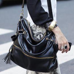 Spring 2015 fashion Korean retro rivet package of large capacity single shoulder bag Xiekua package fringed bag handbag wholesale