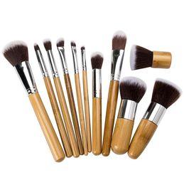 Descuento sistemas de la pluma de madera 11pcs del maquillaje profesional de los cepillos Conjunto de lápiz de sombra de ojos Fundación Corrector Brocha con mango de madera Herramientas de cosméticos al por mayor