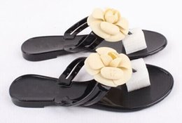 Wholesale Camellia slippers sandals flip flops sandals flat slippers CC Europe station with flat sandals