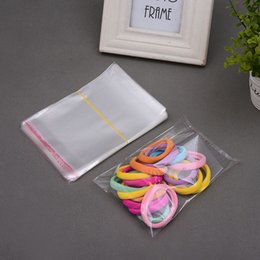 Claro barato pequeña mini bolsas de plástico sello auto-adhesivo al por menor bolsas de embalaje Paquetes desde pequeñas bolsas de plástico adhesivo transparente fabricantes